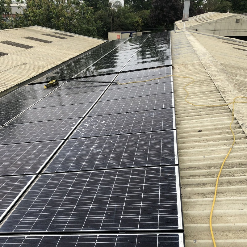 Commercial solar panel clean on building roof