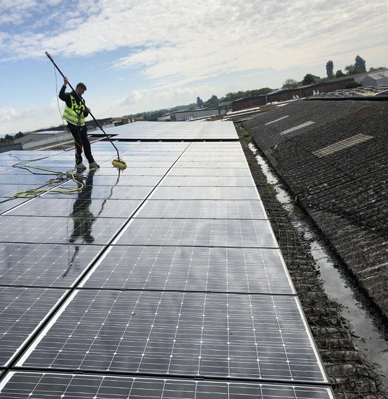 Engineer cleaning solar panels maintenance