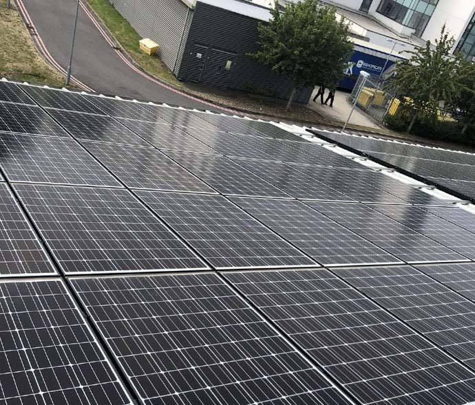 Solar installers on commercial roof