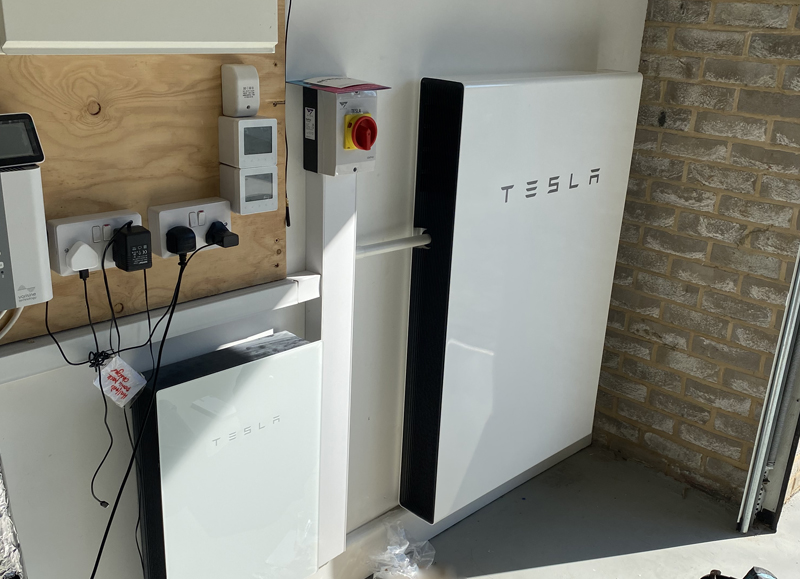 tesla powerwall installed on wall